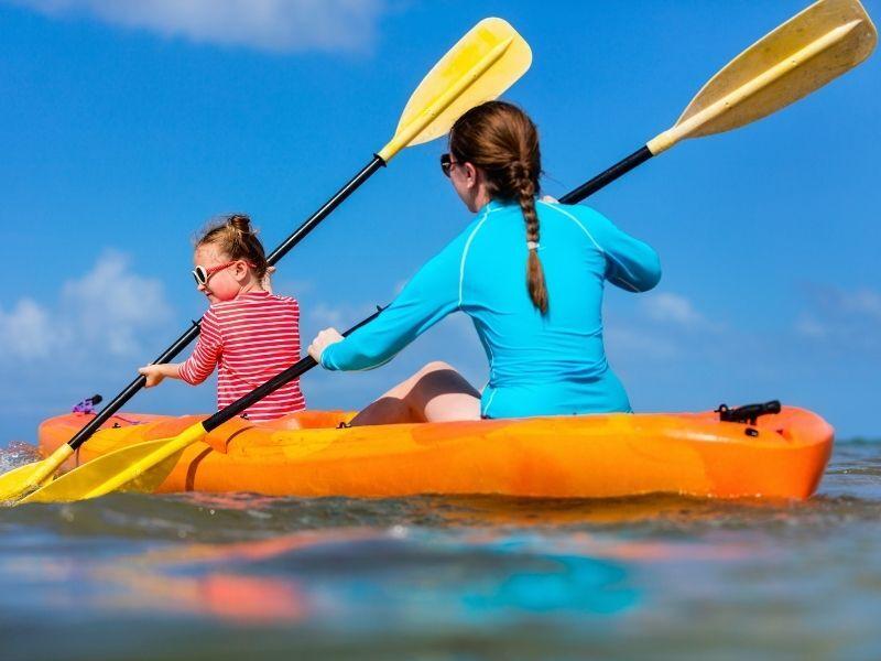 woman and girl kayaking